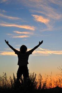 Triumphant man at sunset